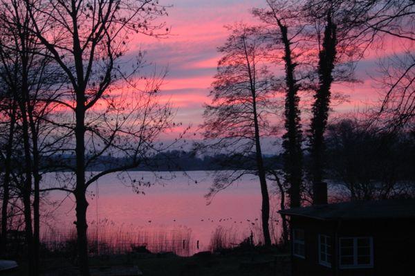 Blick auf den Sonnenuntergang aus dem Ferienhaus